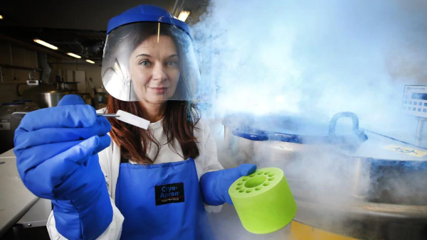 Immunologist Professor Katherine Kedzierska holding a frozen blood sample. ~Picture by: David Caird