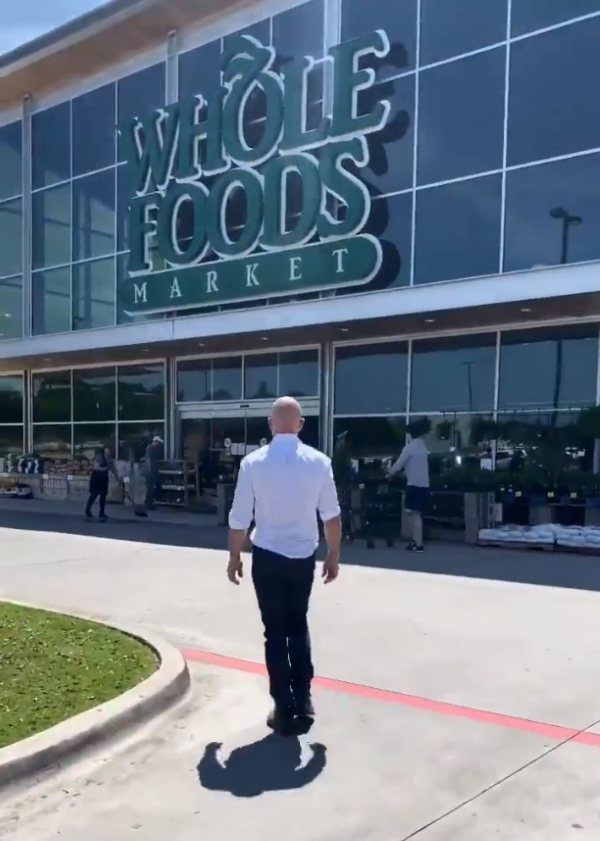 Jeff Bezos visited Amazon employees at an Amazon warehouse and a Whole Foods store